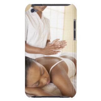 Back massage. Woman receiving a back massage by iPod Touch Case-Mate Case