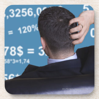 Back portrait of a businessman confused with coaster