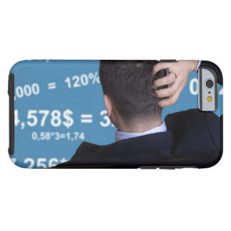 Back portrait of a businessman confused with tough iPhone 6 case