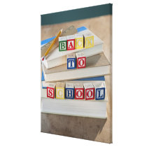 Back to school building blocks on stacked books canvas print