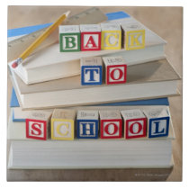 Back to school building blocks on stacked books ceramic tile