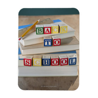 Back to school building blocks on stacked books magnet