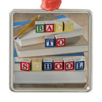 Back to school building blocks on stacked books metal ornament