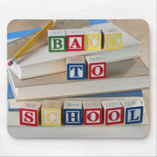 Back to school building blocks on stacked books mouse pad