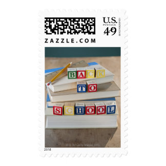 Back to school building blocks on stacked books postage stamp