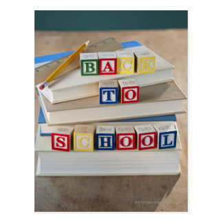 Back to school building blocks on stacked books postcard