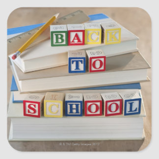 Back to school building blocks on stacked books square sticker