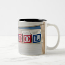 Back to school building blocks on stacked books Two-Tone coffee mug