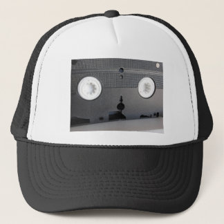 Back view of a single outdated videocassette trucker hat