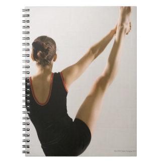 Back view of flexible gymnast notebooks