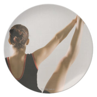 Back view of flexible gymnast dinner plates