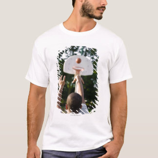 Back view of man shooting basketball outdoors T-Shirt