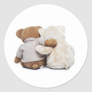 Back view of two Teddy bears hugging each other Classic Round Sticker