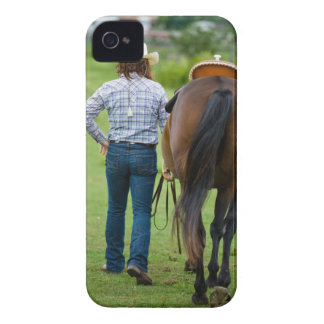 Back view of woman leading her horse iPhone 4 covers