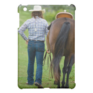 Back view of woman leading her horse cover for the iPad mini