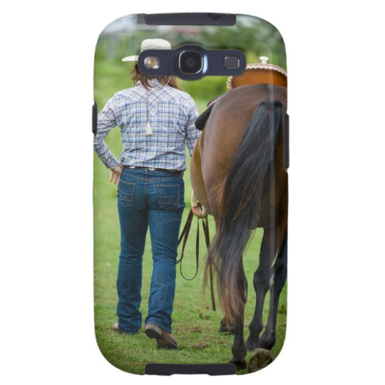 Back view of woman leading her horse samsung galaxy s3 cover
