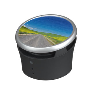 Backcountry road through Spring Canola Fields Bluetooth Speaker