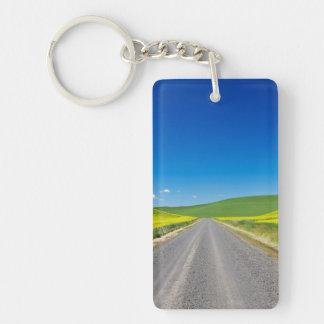 Backcountry road through Spring Canola Fields Double-Sided Rectangular Acrylic Keychain
