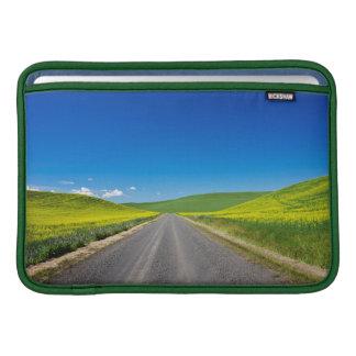 Backcountry road through Spring Canola Fields MacBook Sleeve