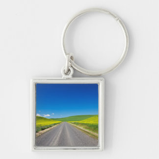 Backcountry road through Spring Canola Fields Silver-Colored Square Keychain