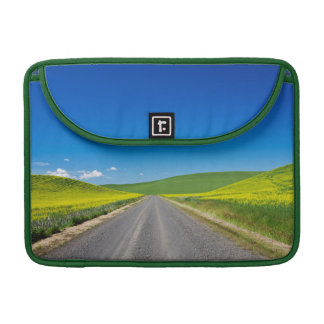 Backcountry road through Spring Canola Fields Sleeve For MacBooks