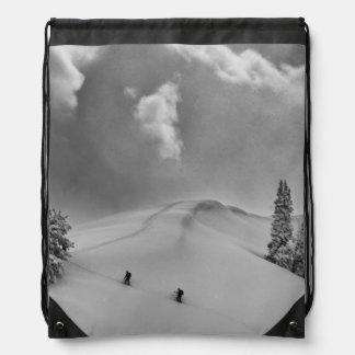 Backcountry Ski Climbers in fresh powder Backpacks