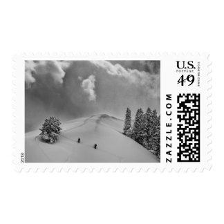 Backcountry Ski Climbers in fresh powder Postage Stamp