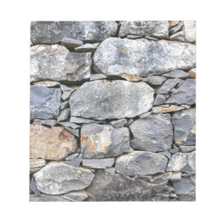 Backgound of natural stones as wall notepad
