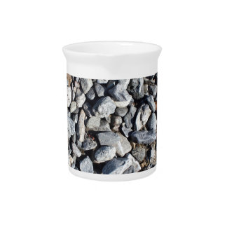Background from gray stones on the coast pitcher