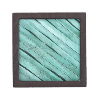 Background from green wooden boards gift box