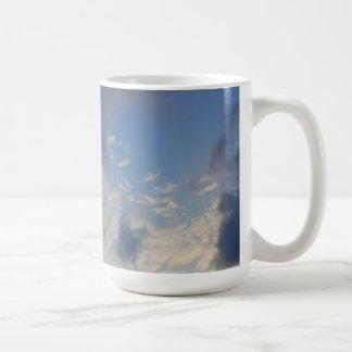 Background of blue sky. coffee mug