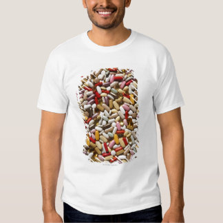 Background of colorful multi-vitamin pills, shirt
