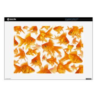 "Background Showing a Large Group of Goldfish 15"" Laptop Skin"