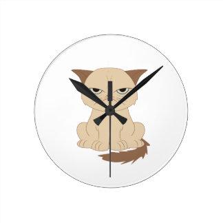 Bad-tempered cat round clock
