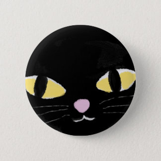 Badge with cat's eyes. button