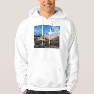 badlands national park scene deep blue cloudy sky hooded pullover