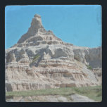 "Badlands National Park South Dakota Stone Coaster<br><div class=""desc"">Capturing the beauty and grandeur of the Badlands, nature photography highlights the rocky outcropping of spires and pinnacles as they are featured in this scenic photo. The clear blue sky and green grasslands of the mixed-grass prairie adds a touch of color to the rugged landscape while shadows fill the fissures...</div>"