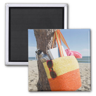 Bag Hanging On Tree Trunk At Sandy Beach 2 Inch Square Magnet