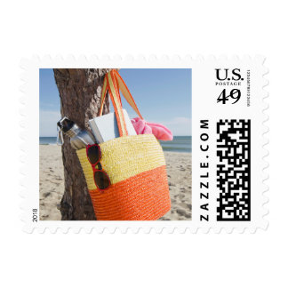Bag Hanging On Tree Trunk At Sandy Beach Postage