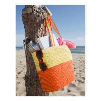 Bag Hanging On Tree Trunk At Sandy Beach Postcard