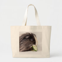 Bag with cute guinea pig eating cucumber