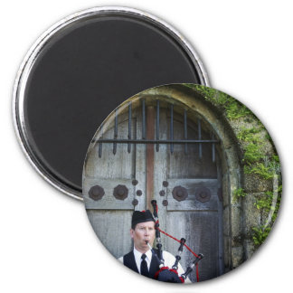 Bagpiper at Castle 2 Inch Round Magnet