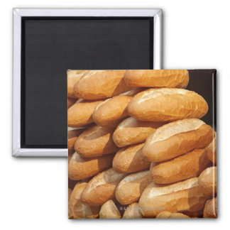 Baguette, bread, for sale in street by hawker. 2 inch square magnet