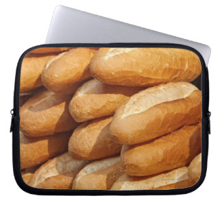 Baguette, bread, for sale in street by hawker. computer sleeve