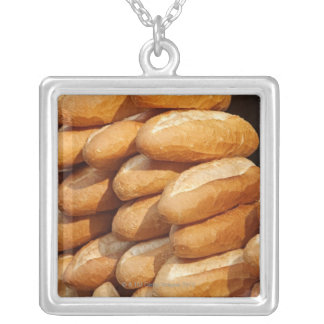 Baguette, bread, for sale in street by hawker. square pendant necklace