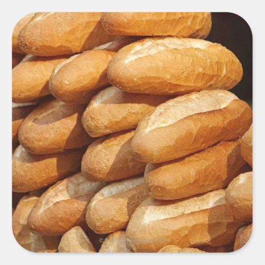 Baguette, bread, for sale in street by hawker. square sticker