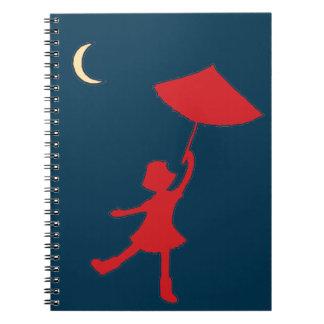 Baile del chica con su paraguas libro de apuntes con espiral