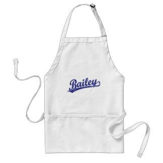 Bailey script logo in blue apron
