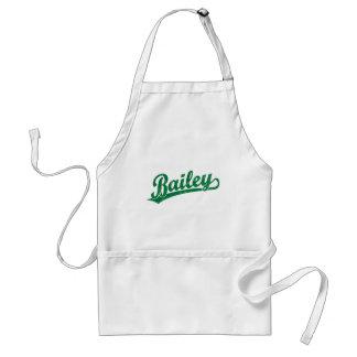 Bailey script logo in green apron