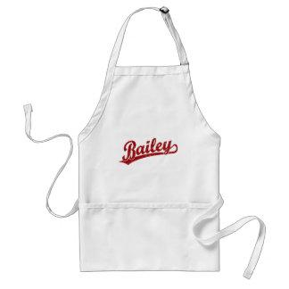 Bailey script logo in red apron